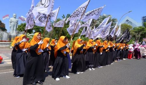 Indonesia: The Call to Hijrah Towards Total Shariah and the Waves of Ar-Rayah and Al-Liwa Flags across 50 Cities